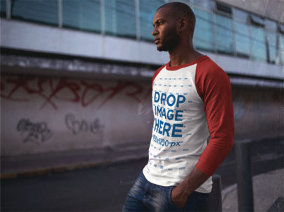 Raglan T-Shirt Mockup of a Serious Guy Standing in the Street a12551