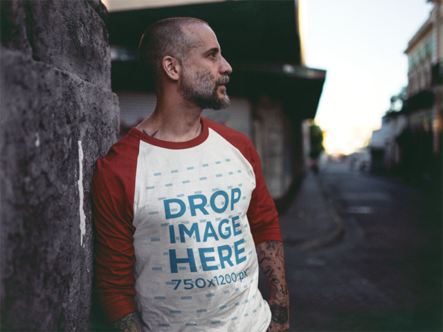 Raglan T-Shirt Mockup of a Tattooed Guy Leaning Against a Wall a12610