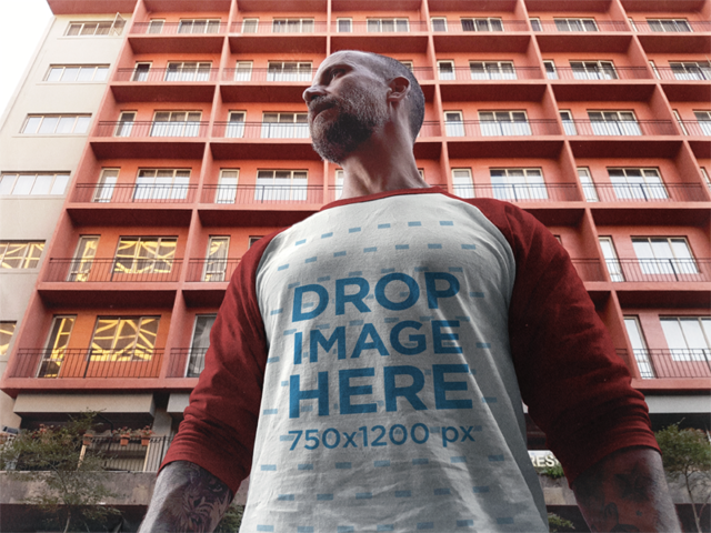 Raglan T-Shirt Mockup Featuring a Middle-Aged Man Out in the Street a12618