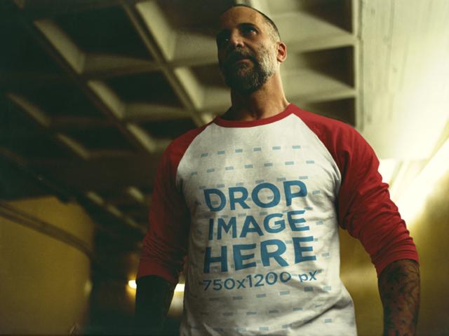 Serious Man Wearing a Raglan T-Shirt Inside a Dark City Parking Lot b12605