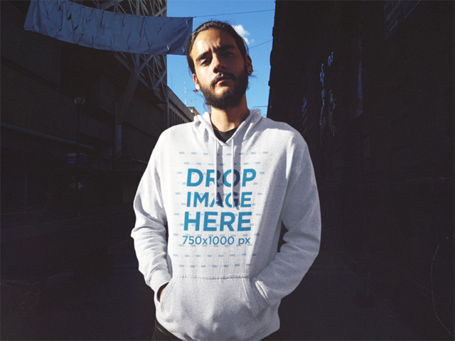 Serious Hipster Guy with a Beard Wearing a Pullover Hoodie Mockup in an Alley b12620