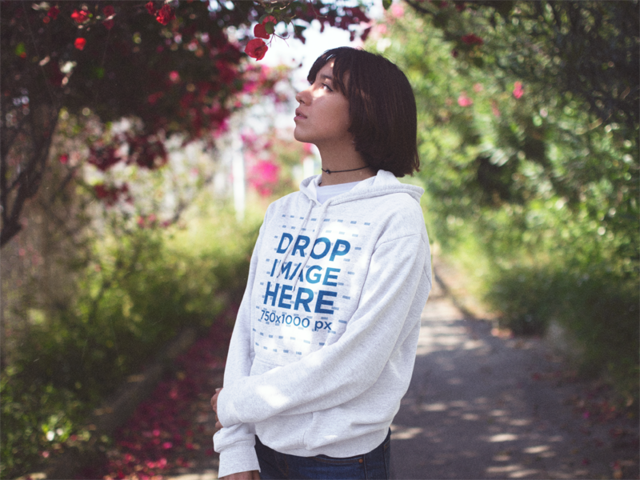 Young Asian Woman with Short Hair Standing in a Garden Pullover Hoodie Mockup a12652