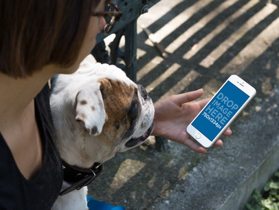 Young Woman Looking at her White iPhone 6s Mockup with her Dog b12929wide
