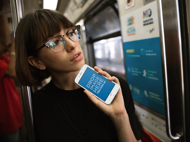 White iPhone 6s Mockup of a Woman on the Metro Checking a Map a12961