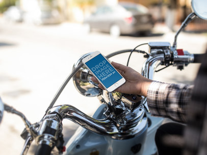 Mockup of a Guy on his Motorcycle Checking his iPhone 6s Before a Ride a12935w