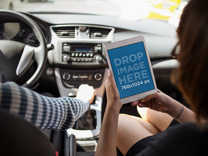 iPad Mini Mockup of a Girl Riding in the Passenger's Seat with her Boyfriend a12945wide