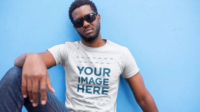 T-Shirt Video Mockup of a Young Black Man with Sunglasses Sitting on the Sidewalk a12117