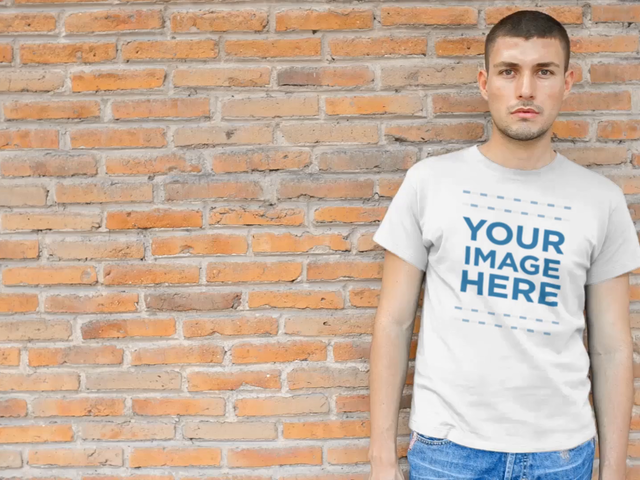 Young Man with a T-Shirt Leaning Against a Brick Wall Video Mockup a12228
