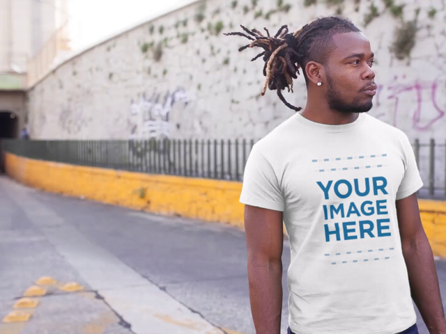 Young Black Man Standing at an Underpass Wearing a Round Neck Tee Video Mockup a12235