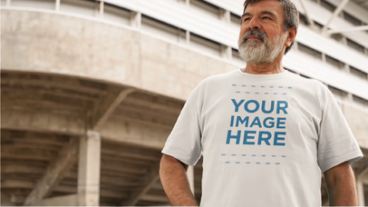 Apparel Video Mockup of a Man with a Beard Wearing a Round Neck Tee at a Stadium a12764