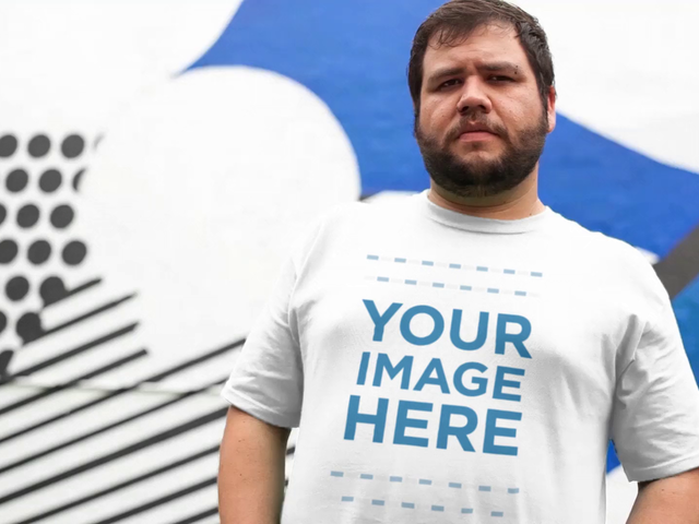 Plus Size Young Man Standing Near a Urban Art in the City T-Shirt Video Mockup a12534