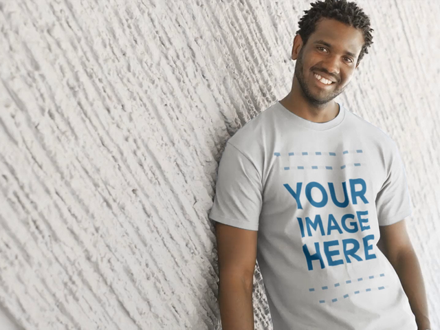 Round Neck Tee Video Mockup of a Young Handsome Black Man Smiling and Leaning on a Wall a12777