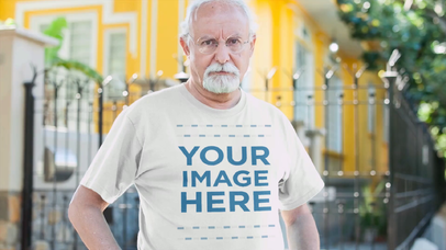 Senior Man with Glasses Out in the Street Wearing a Round Neck T-Shirt Video Mockup a12785