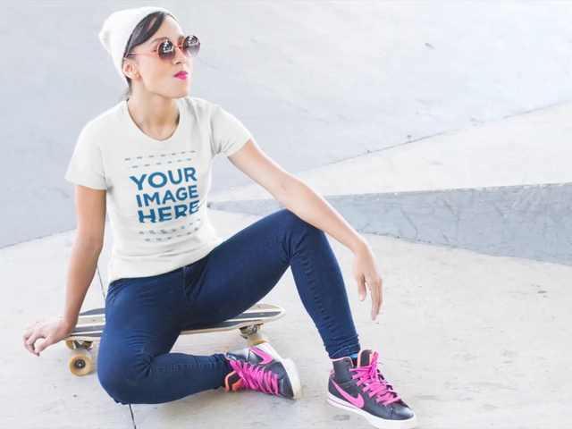 Tee Video Mockup of a Girl Sitting on her Skateboard in the Street a12831