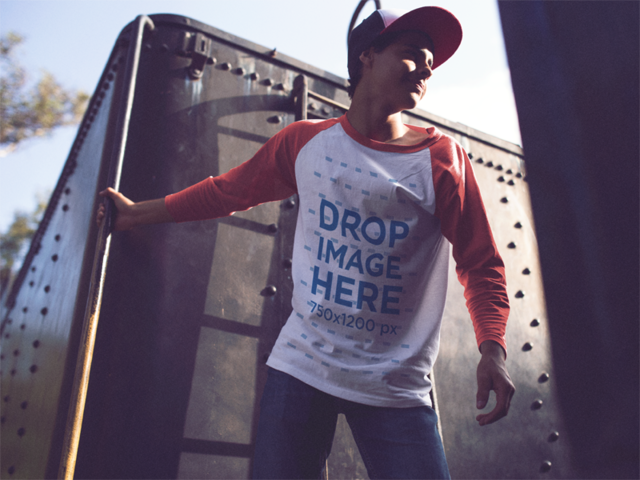 Trendy Young Man Holding onto a Train Wagon Raglan Tee Mockup a12515