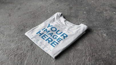 4 Round Neck T-Shirts Stacking on a Concrete Surface Stop Motion Video Mockup a13148
