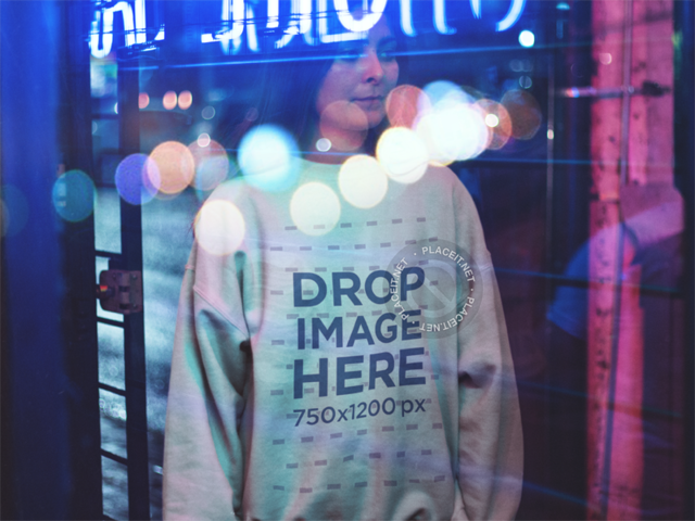 Crewneck Mockup of a Pretty Young Woman in a Coffee Shop at Night a12689