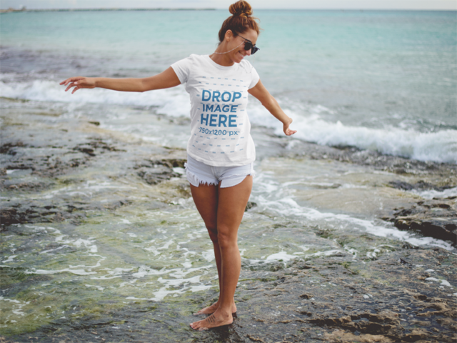 Trendy Girl at the Beach Wearing a Round Neck Tee Mockup and Shorts a12727