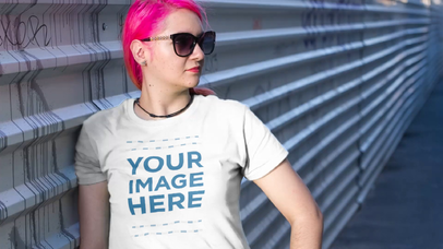 Trendy Girl with Sunglasses Wearing a T-Shirt in the Street Video Mockup a12639