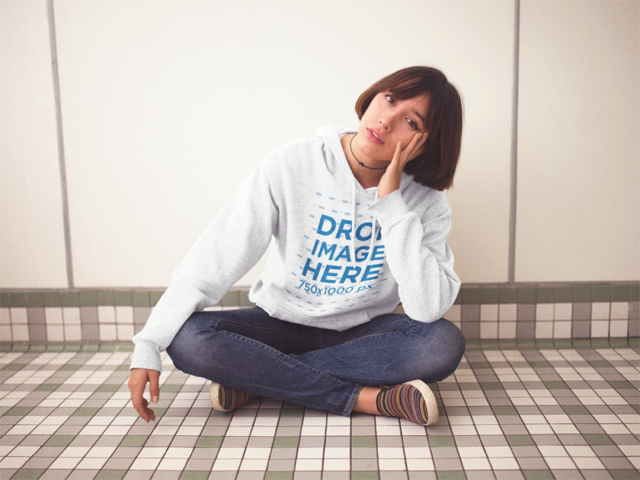 Pullover Hoodie Mockup of a Trendy Girl Sitting Cross-Legged in a Room a12662