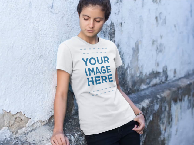 T-Shirt Video Mockup of a Young Woman Leaning on a Street Wall a12858