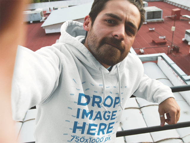 Cool Guy Wearing a Pullover Hoodie Mockup and Taking a Selfie a12910