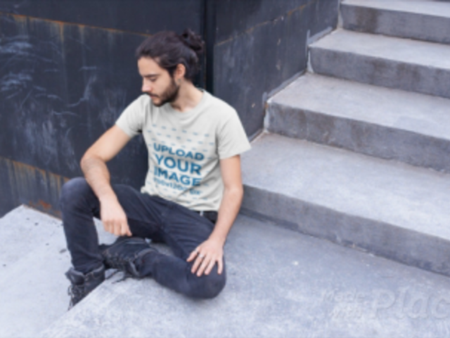T-Shirt Video Mockup of a Cool Bearded Man Relaxing in an Urban Scenario 12978