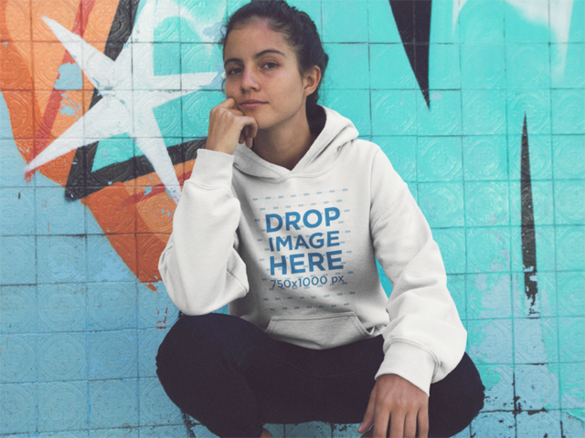 Pretty Girl Crouching in a Abandoned Pool Wearing a Pullover Hoodie Mockup a12850