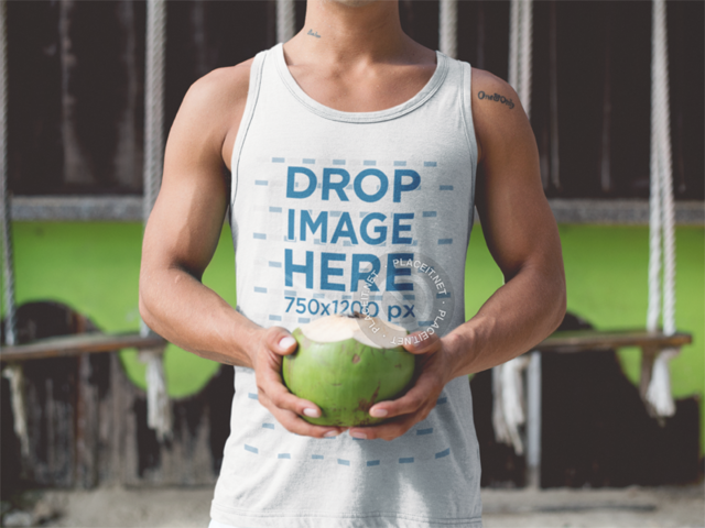 Tank Top Mockup of a Guy at the Beach Drinking a Coconut a12735