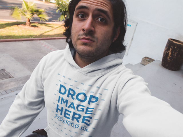 Hoodie Mockup of a Young Man with Long Hair Taking a Selfie a12908