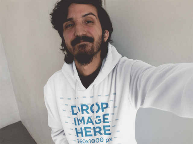 Hoodie Mockup of a Guy with Long Hair and Beard Taking a Selfie a12899