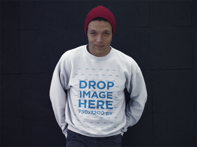 Crewneck Mockup of a Guy Standing in Front of a Black Wall with a Beanie a13199