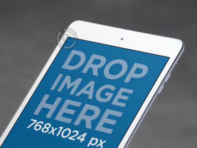 White iPad Mini in Angled Close-Up View Mockup a12759