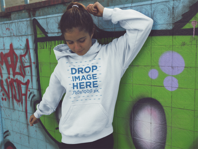 Hoodie Mockup of a Lovely Girl with a Ponytail at a Graffiti Wall a12851