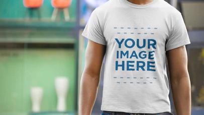 Black Man Standing in the Street Wearing a T-Shirt Closeup Video Mockup a12355