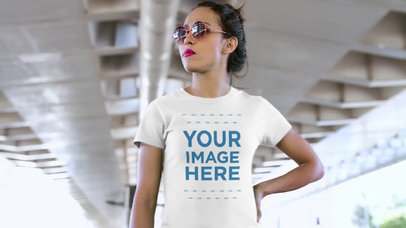 Woman with Sunglasses Waiting for a Friend Under a Bridge T-Shirt Video Mockup a12829