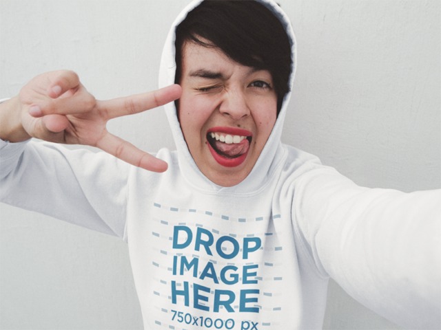 Hoodie Mockup of a Trendy Girl Taking a Selfie with a Funny Face a12898