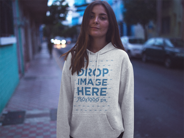 Pretty Girl on the Street at Dusk Wearing a Pullover Hoodie Mockup a12719
