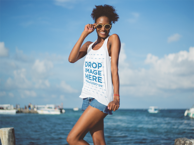 Lovely Tank Top Mockup Featuring a Smiling Young Black Woman at the Beach a12739