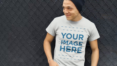 Young Man Wearing a Beanie and Round Neck T-Shirt Hanging Around Video Mockup a13026