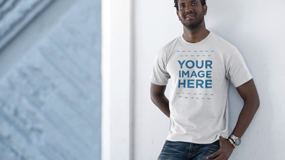 T-Shirt Video Mockup of a Young Black Man Laughing and Leaning Against a Wall a12776