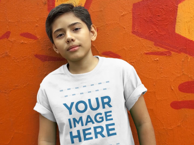 T-Shirt Video Mockup of a Young Boy Wearing a Kid's Round Neck Tee Leaning Against a Graffiti Wall and Smiling c12769