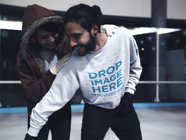 Young Man Playing with his Girlfriend at a Skating Rink Wearing a Crewneck Mockup a13250