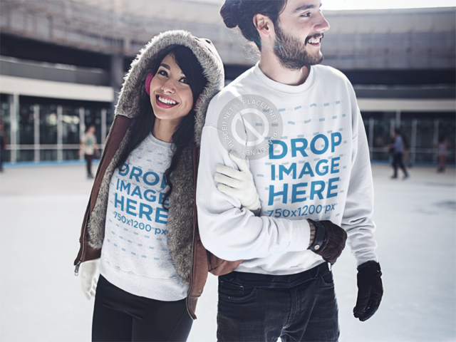 Young Smiling Couple Skating in Winter Wearing Matching Crewnecks Mockup b13249