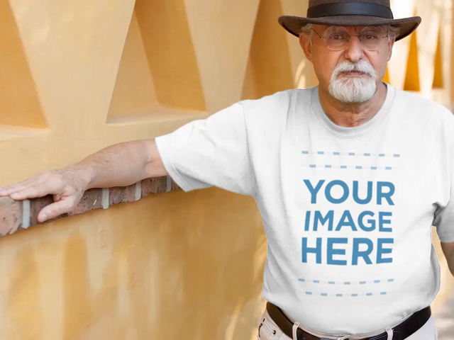 Senior Man with Glasses Having a Chat in the Street Wearing a T-Shirt Mockup Video a12786