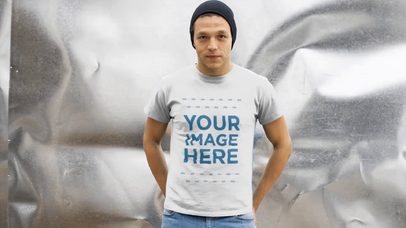 Young Man Wearing a Beanie and T-Shirt Video Mockup in a Storage Room a13025-121916