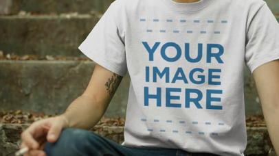 T-Shirt Video Mockup of a Guy Sitting on Some Stairs Having a Cigarette a12862