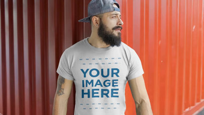 Guy with a Snapback Hat Wearing a Round Neck T-Shirt Video Mockup in a Shipyard a12264-121916