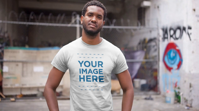 T-Shirt Video Mockup of a Handsome Black Man Standing in an Abandoned City Building a12119-122016