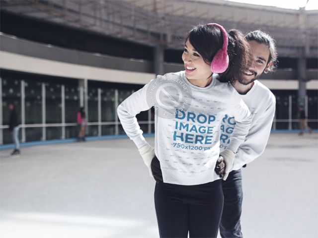 Smiling Couple Skating Together Wearing Matching Crewnecks Mockup a13251